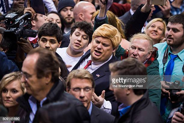 A man dressed as republican presidential candidate Donald Trump shouts to Trump as he greets supporters after speaking at a campaign rally at the...
