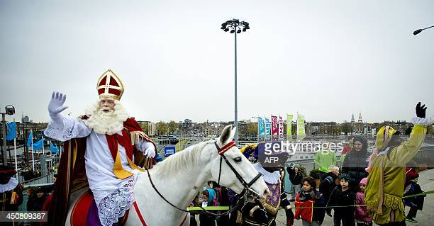 A man dressed as Saint Nicholas rides his horse Amerigo on the roof of the NEMO technology Museum in Amsterdam on November 20 a few days before the...