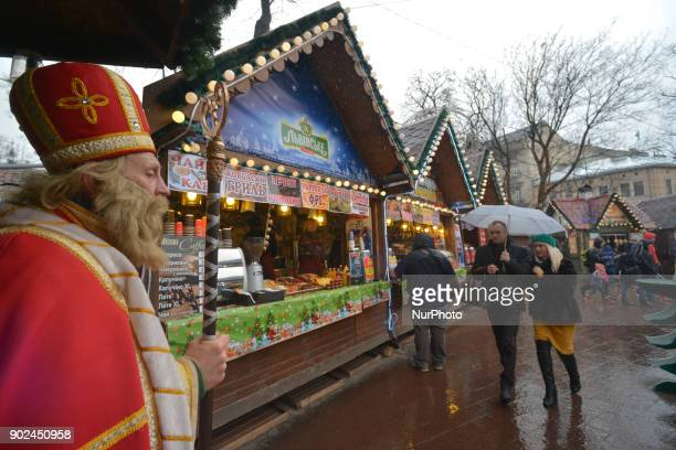 A man dressed as Saint Nicholas seen on Orthodox Christmas Day at Christmas Fair located not far from the Opera House on Svobody Avenue in Lviv's...