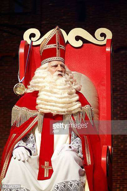 A man dressed as Saint Nicholas takes part in the 'Club of Saint Nicolas Party Tour' at the Ahao in Rotterdam on November 23 2013 AFP PHOTO/ANP BAS...