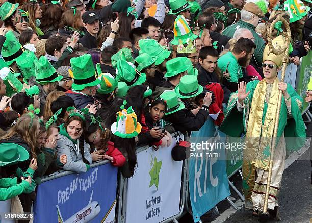 A man dressed as Saint Patrick works his way along the crowd on O'Connell Street during the St Patrick's day parade as the largest St Patrick's day...