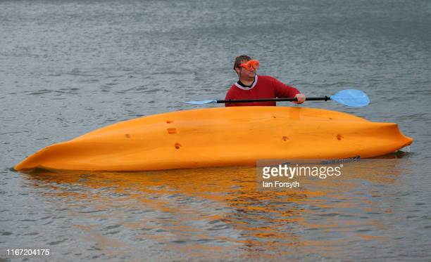A man dressed as Santa capsizes his kayak during the annual Whitby Regatta on August 10 2019 in Whitby England At over 170 years old the Whitby...