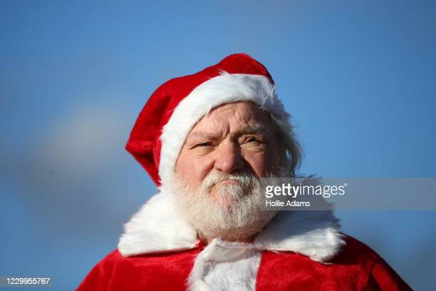 Man dressed as Santa Claus attends a demonstration against the current Covid-19 restrictions in Hyde Park on December 5, 2020 in London, England....