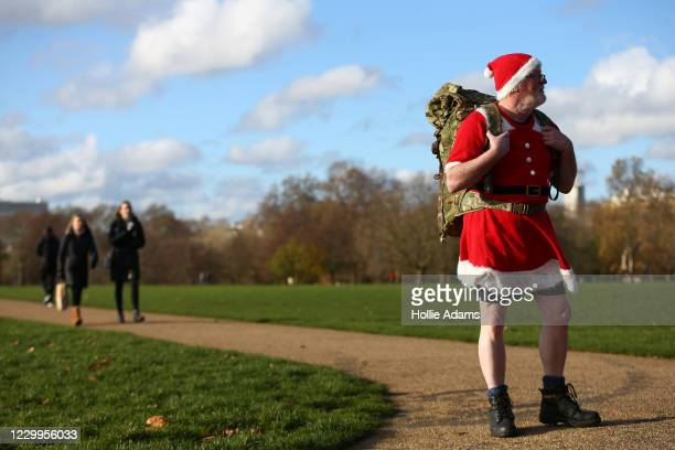 Man dressed as Santa Claus attends a demonstration against the current Coivd-19 restrictions in Hyde Park on December 5, 2020 in London, England....