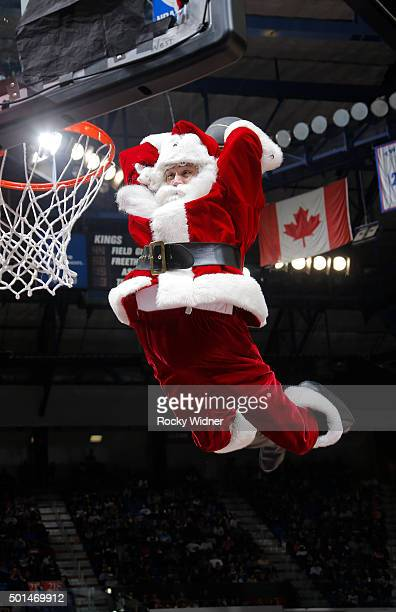 Man dressed as Santa Claus dunks during the game between the New York Knicks and Sacramento Kings on December 10, 2015 at Sleep Train Arena in...