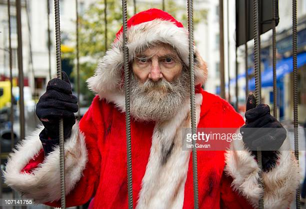 A man dressed as Santa Claus looks out from a cage during a photocall to promote the film 'Rare Exports A Christmas Tale' at Carnaby Street on...