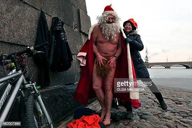A man dressed as Santa Claus prepares before a naked bath in the Neva river in the center of St Petersburg on January 12 2013 AFP PHOTO/OLGA MALTSEVA