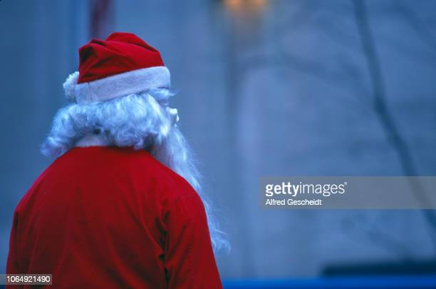 A man dressed as Santa Claus seen from behind near the Rockefeller Center New York City US 1986
