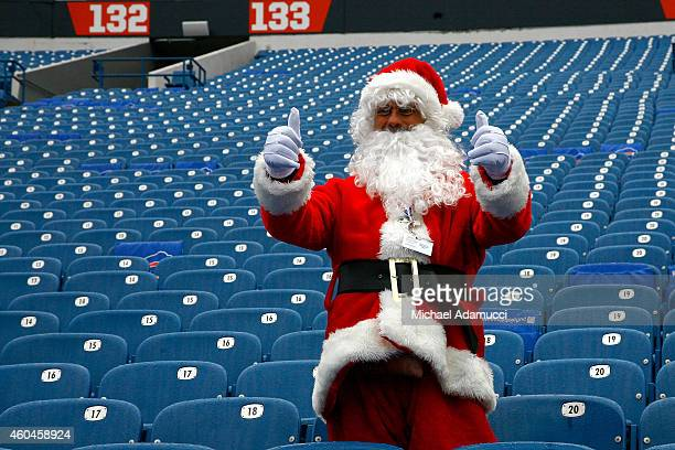 A man dressed as Santa Claus watches warmups from the stands before the game between the Green Bay Packers and the Buffalo Bills at Ralph Wilson...