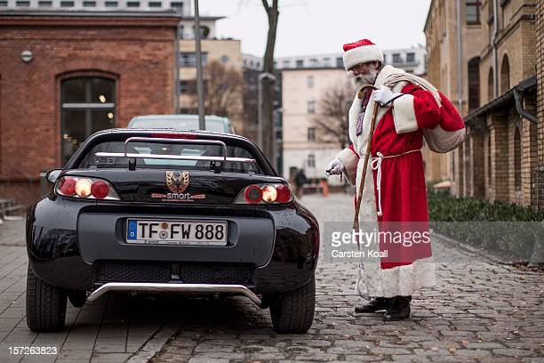 A man dressed as Santa leaves the meeting where students gathered for their annual preChristmas gathering at the cafeteria of the Studentenwerk Nord...