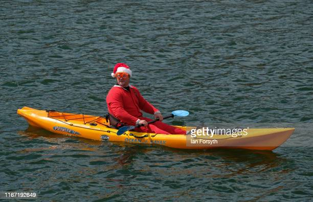A man dressed as santa sits in his kayak during the annual Whitby Regatta on August 10 2019 in Whitby England At over 170 years old the Whitby...