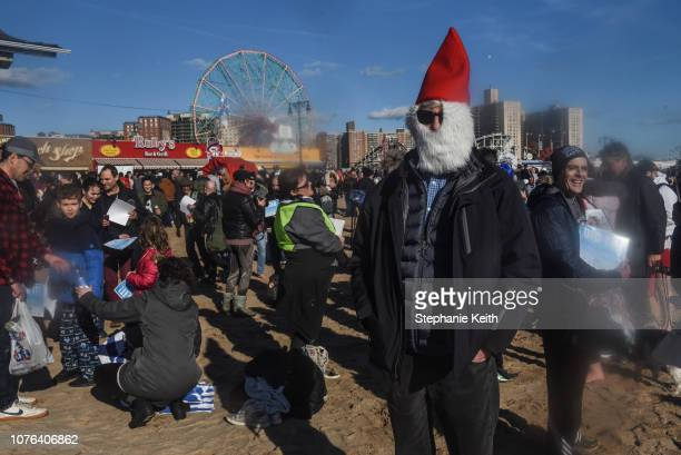 A man dressed as Santa stands on the beach after the annual Polar Bear Plunge on New Year's Day in Coney Island on January 1 2019 in the Brooklyn...