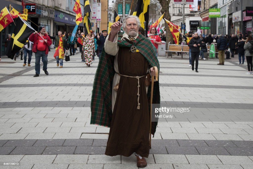 A man dressed as St David leads a parade, one of the largest events being held in Wales, to mark St David's Day, on March 1, 2017 in Cardiff, Wales. Across Wales numerous events are taking place to mark the day and to celebrate Welsh heritage and culture. St David, also known as Dewi Sant in Welsh, is the patron saint of Wales and although many associate St David with leeks or daffodils, his symbol is actually the Dove, which usually rests on his shoulder.