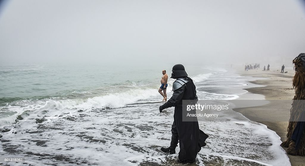 A man dressed as Star Wars character Darth Vader attends the Epiphany holiday celebration at the seashore in Odessa, Ukraine on January 19, 2015.