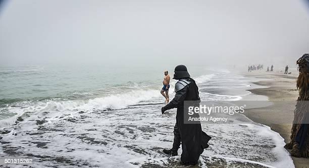 A man dressed as Star Wars character Darth Vader attends the Epiphany holiday celebration at the seashore in Odessa Ukraine on January 19 2015