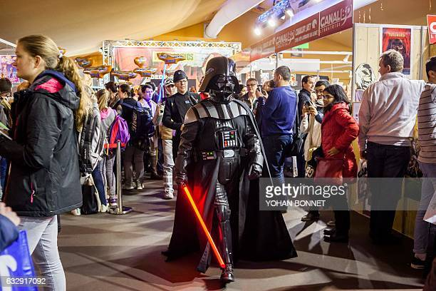 A man dressed as Star Wars iconic character Darth Vader is seen during the 44th international comic book festival on January 28 2017 in Angouleme /...