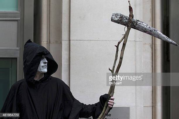 A man dressed as the Grim Reaper stands on a union picket line as he takes industrial action outside the offices for the National Offender Management...