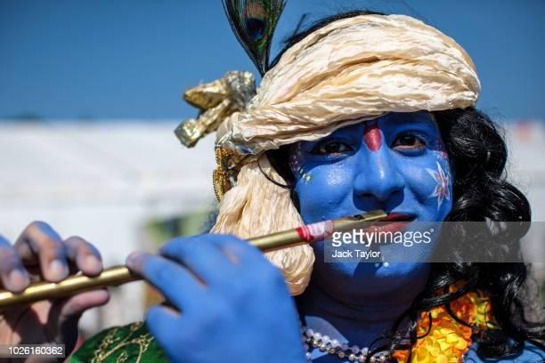 A man dressed as the Hindu god Lord Krishna poses during the Janmashtami Festival at Bhaktivedanta Manor on September 2 2018 in Watford England...