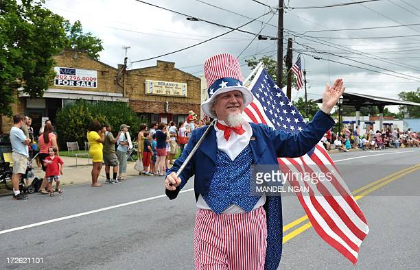 A man dressed as Uncle Sam takes part in the Independence Day parade in Takoma Park Maryland on July 4 2013 Independence Day celebrates the...