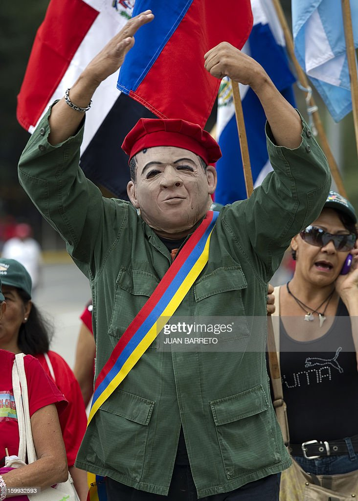 A man dressed as Venezuelan President Hugo Chavez takes part in a rally to commemorate the 55th anniversary of the end of the dictatorship (1952-1958) of Marcos Perez Jimenez in Caracas on January 23, 2013. Thousands of Venezuelans marched in support of cancer-stricken President Hugo Chavez in Caracas Wednesday on the anniversary of the day the country's last dictator was overthrown. AFP PHOTO