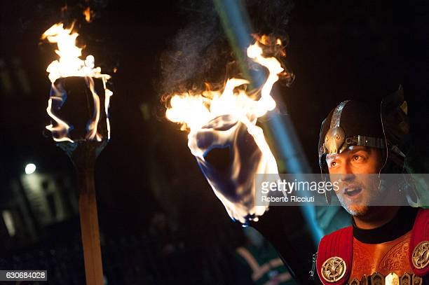 A man dressed as viking takes part at a photocall before participating in the Torchlight Procession during Edinburgh's Hogmanay celebrations on...