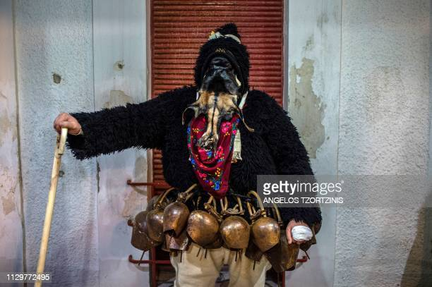 A man dressed in a costume of ''Old man'' poses during the Skyrian Carnival on the island of Skyros northeast of Athens on March 9 2019 In the...