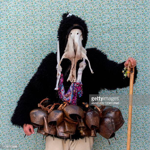 A man dressed in a costume of 'Old Man' poses for a portrait during the Skyrian Carnival on the island of Skyros northeast of Athens on March 10 2019...