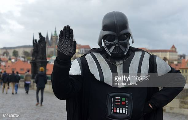 A man dressed in a costume of Star Wars character Darth Vader poses on the Charles Bridge on November 10 2016 in Prague / AFP / Michal Cizek