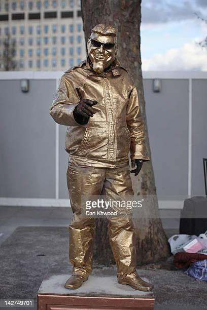 A man dressed in a golden outfit stands on the South Bank on April 11 2012 in London England The South Bank which runs alongside the River Thames is...