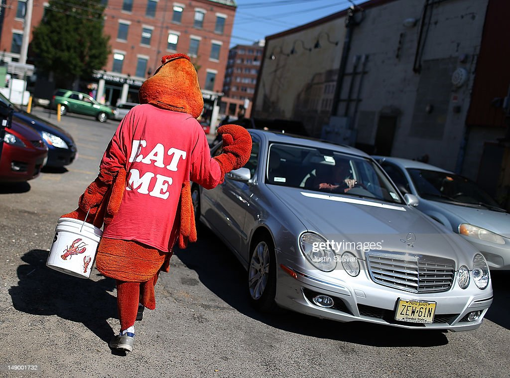 A man dressed in a lobster costume tries to lure customers to Three Sons Lobster and Fish on July 21, 2012 in Portland, Maine. A mild winter and warmer than usual spring caused lobsters to shed their shells six weeks earlier than usual which resulted in an overabundance of lobsters in the Northeastern United States that has driven down prices to record lows. Lobstermen hope to make at least $4.00 a pound to turn a profit but prices this year have been as low as $1.25 a pound.