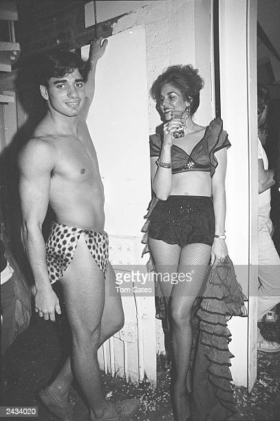 A man dressed in a loincloth and a woman wearing a Flamenco costume talk during the Haloween party at the nightclub Studio 54 New York City October...