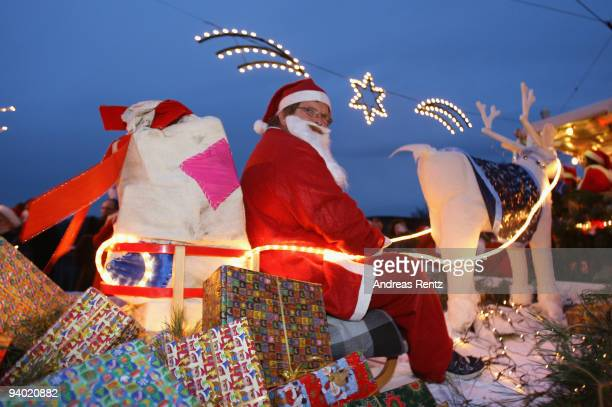 A man dressed in a Santa Claus outfit sits on a sledge during the 11th Santa Clauses parade on December 5 2009 in Brandenburg near Berlin Germany...