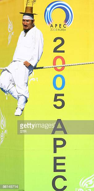 Man dressed in a traditional Korean costume performs on a tight-rope in a city-organized program to expose traditional Korean culture to foreigners,...