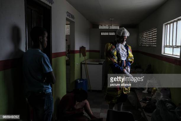 A man dressed in a traditional Maracatu costume prepares for his group to attend the carnival parade in Nazare de Mata Brazil 13 February 2018 Nazare...