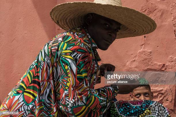 A man dressed in a traditional Maracatu costume waits for his group to attend the carnival parade in Nazare de Mata Brazil 13 February 2018 Nazare de...