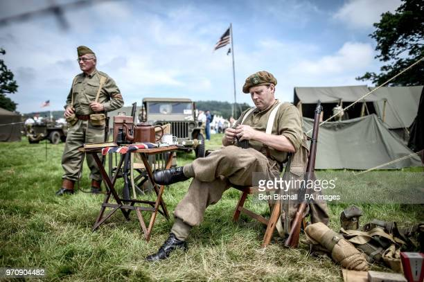 A man dressed in a WWII uniform fills a rifle magazine with ammunition at the Dig for Victory Show a festival that celebrates the 1940's at the North...