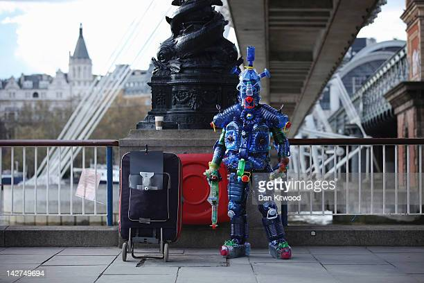 A man dressed in an outfit made from plastic bottles stands on the South Bank on April 11 2012 in London England The South Bank which runs alongside...