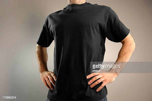 man dressed in black t shirt - t shirt stock pictures, royalty-free photos & images