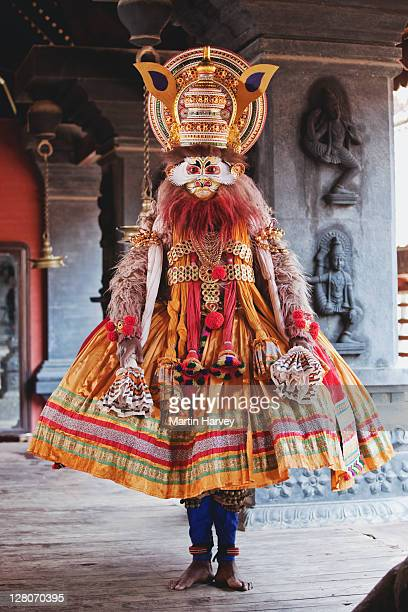 Man (20 years old) dressed in character from Kathakali, classified as classical Indian dance-drama the characters put on attractive make-up and elaborate costumes. It originated in Kerala during the 17th century AD. Cheruthuruthy, Thrissur, India