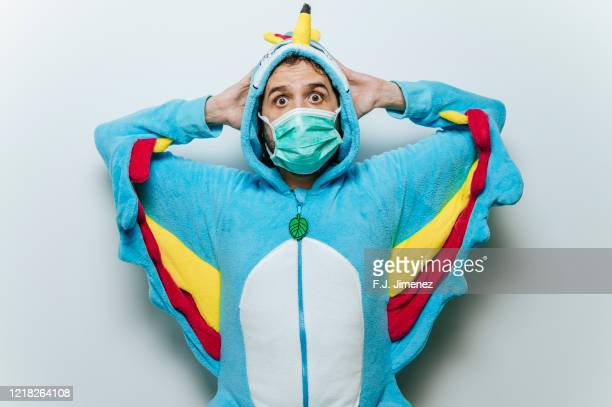man dressed in chicken costume with medical mask - funny surgical masks stock pictures, royalty-free photos & images