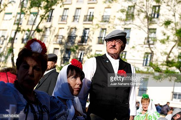 A man dressed in chulapo looks on during the festivities on May 14 2013 in Madrid Spain These festivities are in honor of San Isidro Labrador and are...