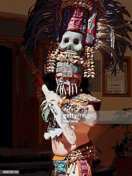 Man dressed in costume Indian fierce warrior in San cristobal de Casals
