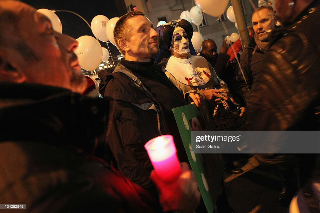 A man dressed in drag joins marchers mourning the victims of AIDS on November 30, 2011 in Berlin, Germany. Several hundred people, mostly members of the city's gay community, participated in the march one day ahead of World AIDS Day.
