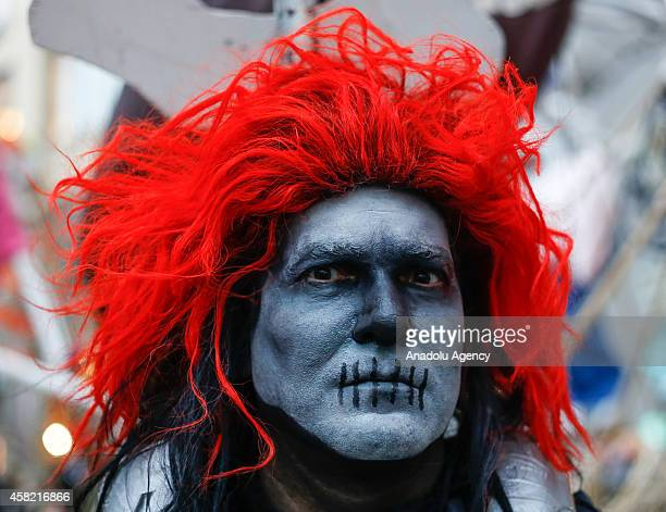 A man dressed in Halloween costume takes part in Halloween celebrations held within 41st annual Village Halloween parade under the theme of 'The...