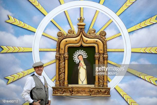 A man dressed in Madrid's traditional attire Chulapos poses during the Feast of La Paloma Virgin in Madrid on August 13 2018 Madrid's history and...