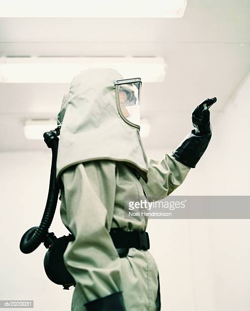 man dressed in protective mask and clothing - hazmat stock pictures, royalty-free photos & images