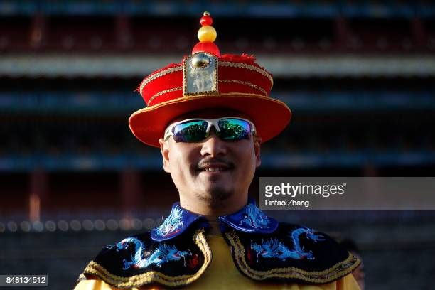 A man dressed in Qing Dynasty Emperor before during the 2017 Beijing Marathon at Tiananmen Square on September 17 2017 in Beijing China