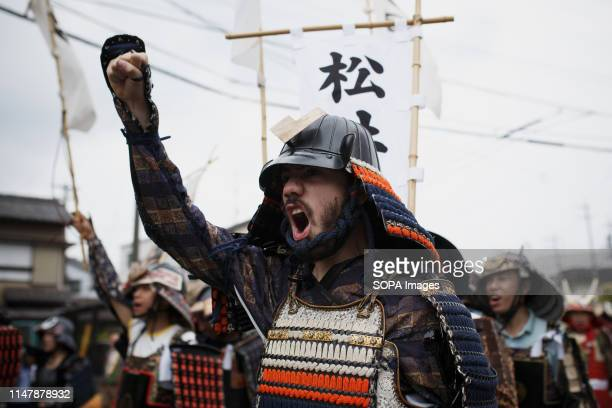 A man dressed in samurai warrior armour chants slogans during the Okehazama Historical Battlefield Festival in Aichi toyoake In 1560 Oda Nobunaga and...