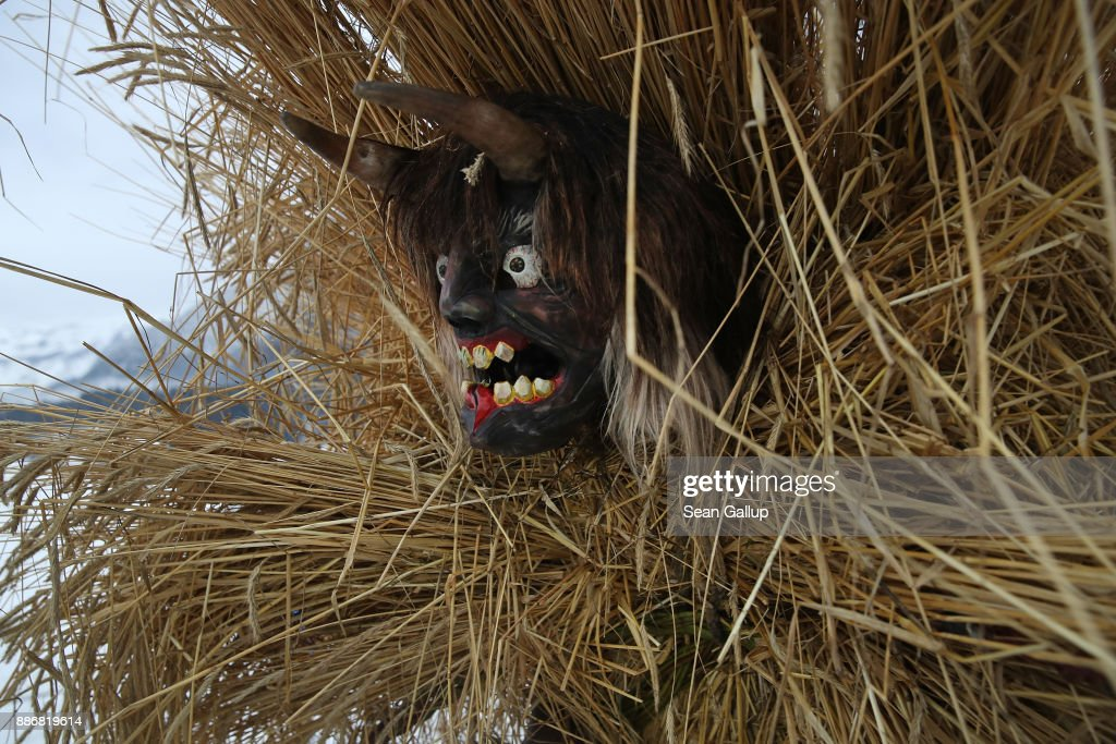A man dressed in straw and a wooden mask in the form of a figure known locally as 'Buttnmandl', or 'Shaking Man', ascends to gather with other Buttnmandls on a meadow above the town in an annual tradition on December 5, 2017 in Berchtesgaden, Germany. Buttnmandl wears heavy cowbells that he rings by shaking his hips. His role is to drive away the evils spirits of winter and awaken slumbering Mother Nature. He also accompanies Saint Nicholas and goes house to house, visiting families as Saint Nicholas hears which children have been good and which have been bad. Buttnmandl is specific to the Berchtesgadener Land region of southeastern Bavaria but is similar in intent to the more common Krampus, the fur-clad figure with a terrifying mask that has, especially in recent decades, become an intrinsic part of local folklore throughout late November and most of December in the alpine regions of Germany, Austria and Italy.