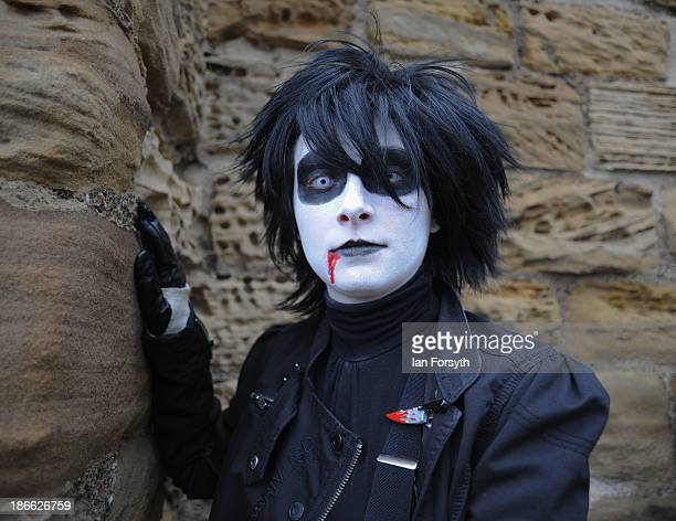 Man dressed in the style of Edward Scissorhands poses for the camera as he visits the Goth weekend on November 2, 2013 in Whitby, England. The Whitby...